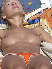 Sexy bikini girls getting suntanned bare titted